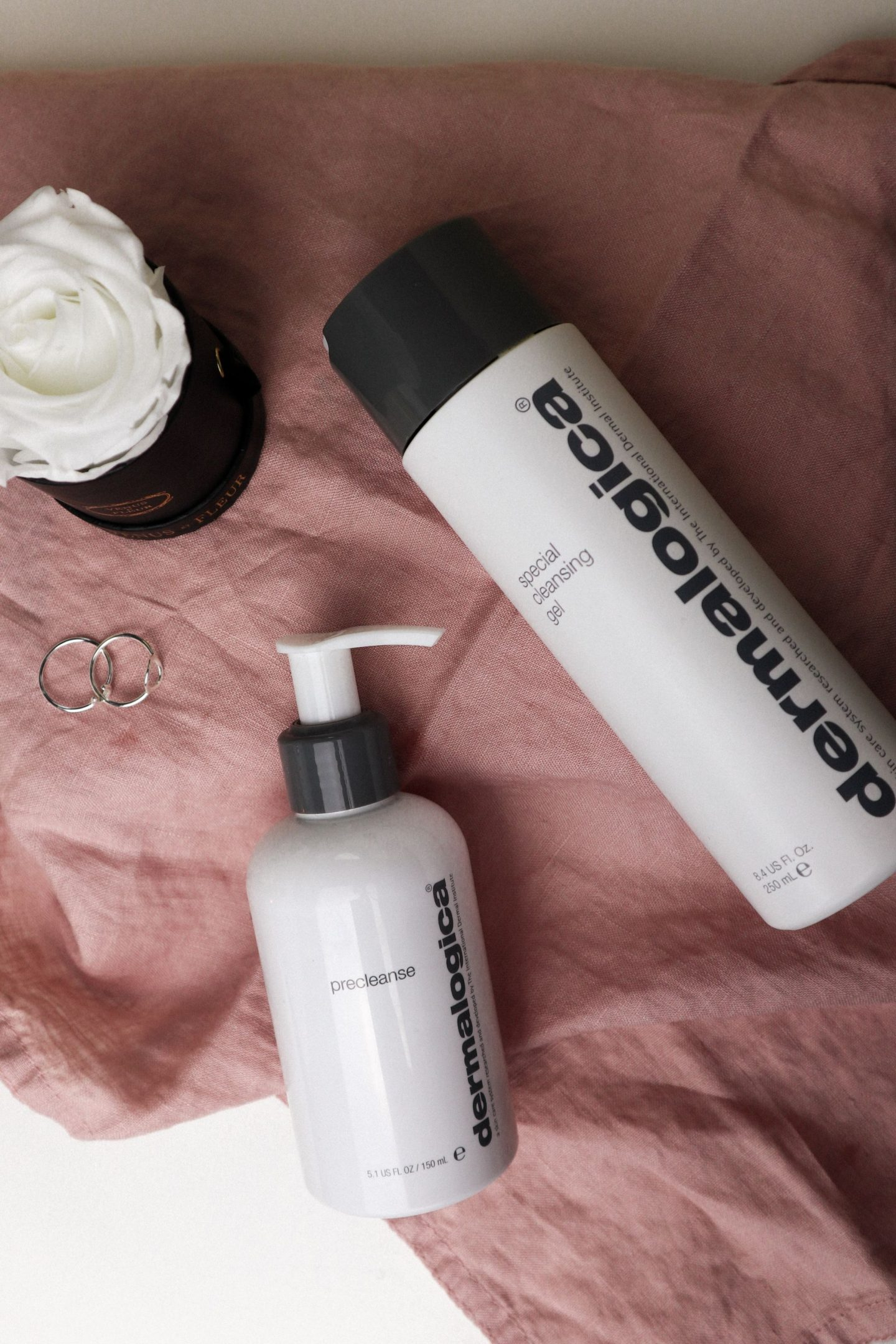 which products to use for double cleansing- dermalogica precleanse and special cleansing gel on pink surface