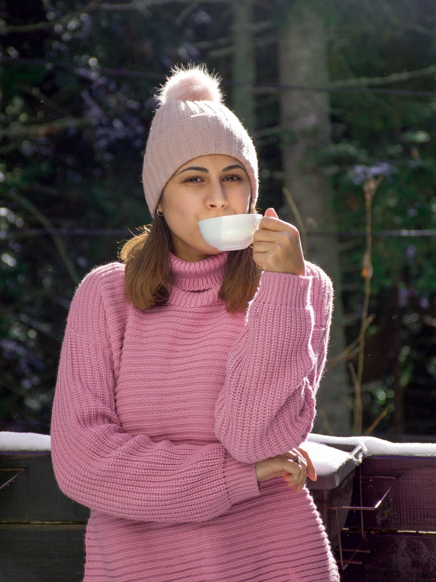 Girl with a cup of tea in the mountains