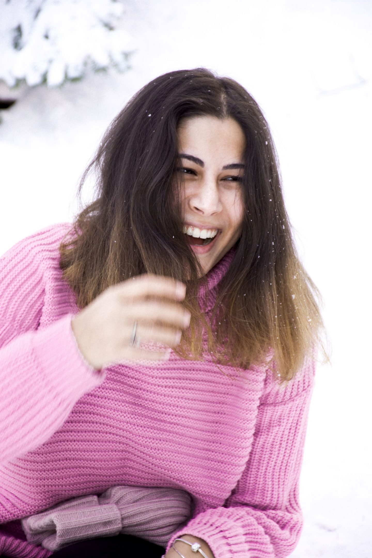 Kristina laughing in the snow