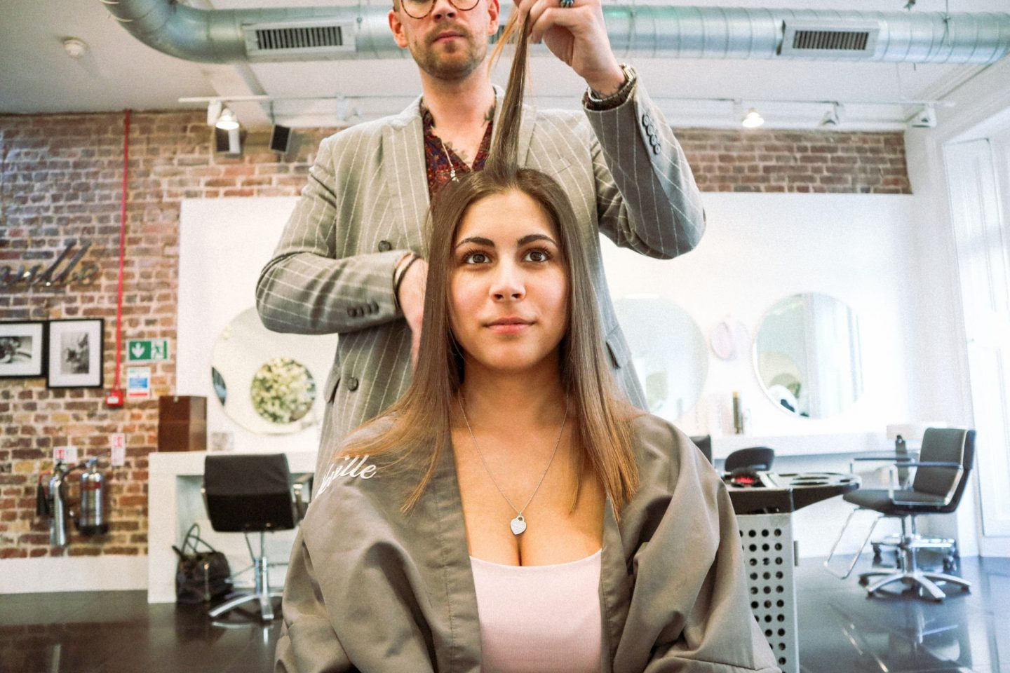 Woman in hair salon gettin Braliz Hair Straightening Treatment