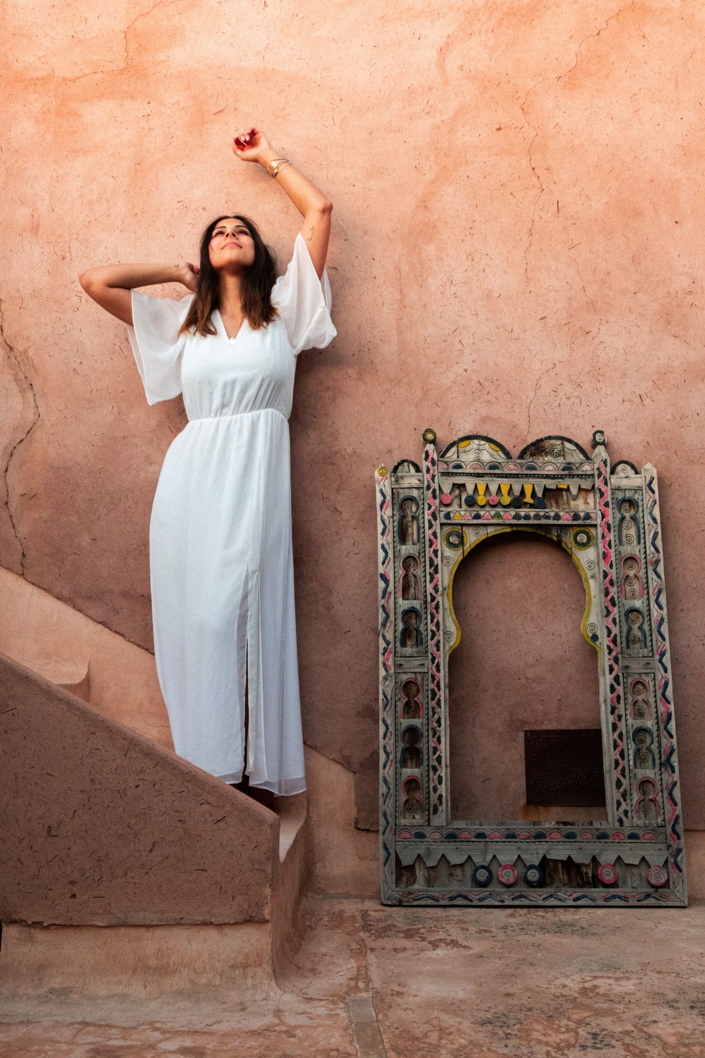 Kristina standing by the wall at Riad Up, Marrakesh, Morocco