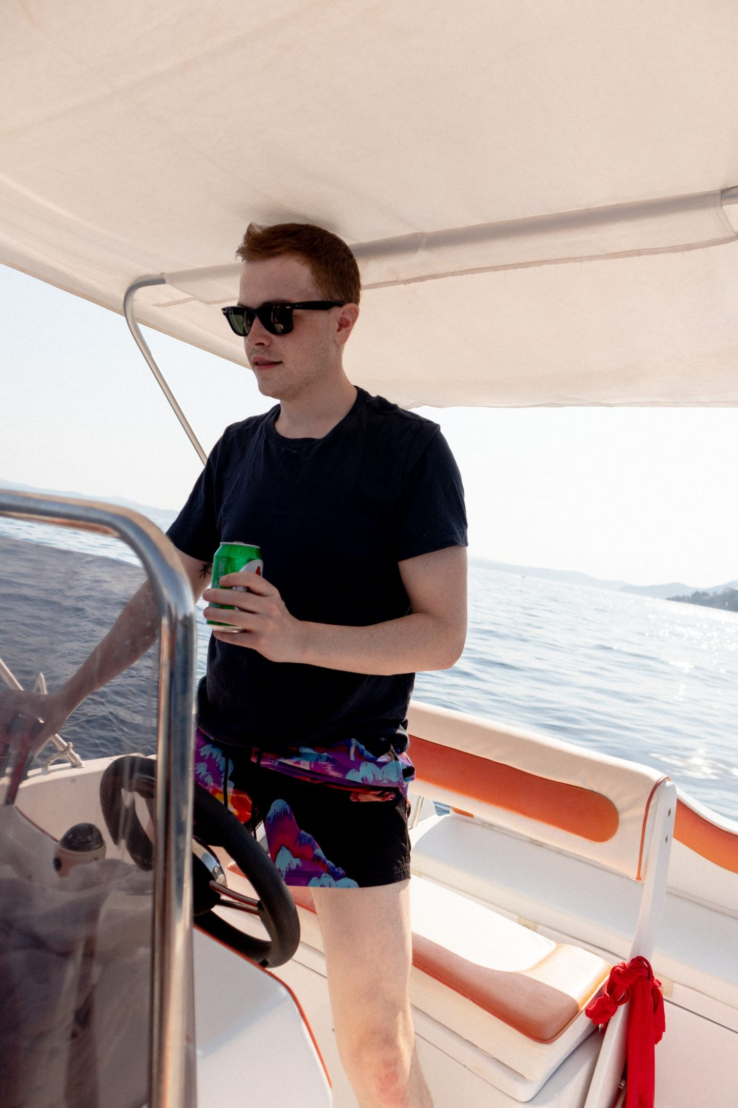 Simon is driving a boat in Corfu, Greece