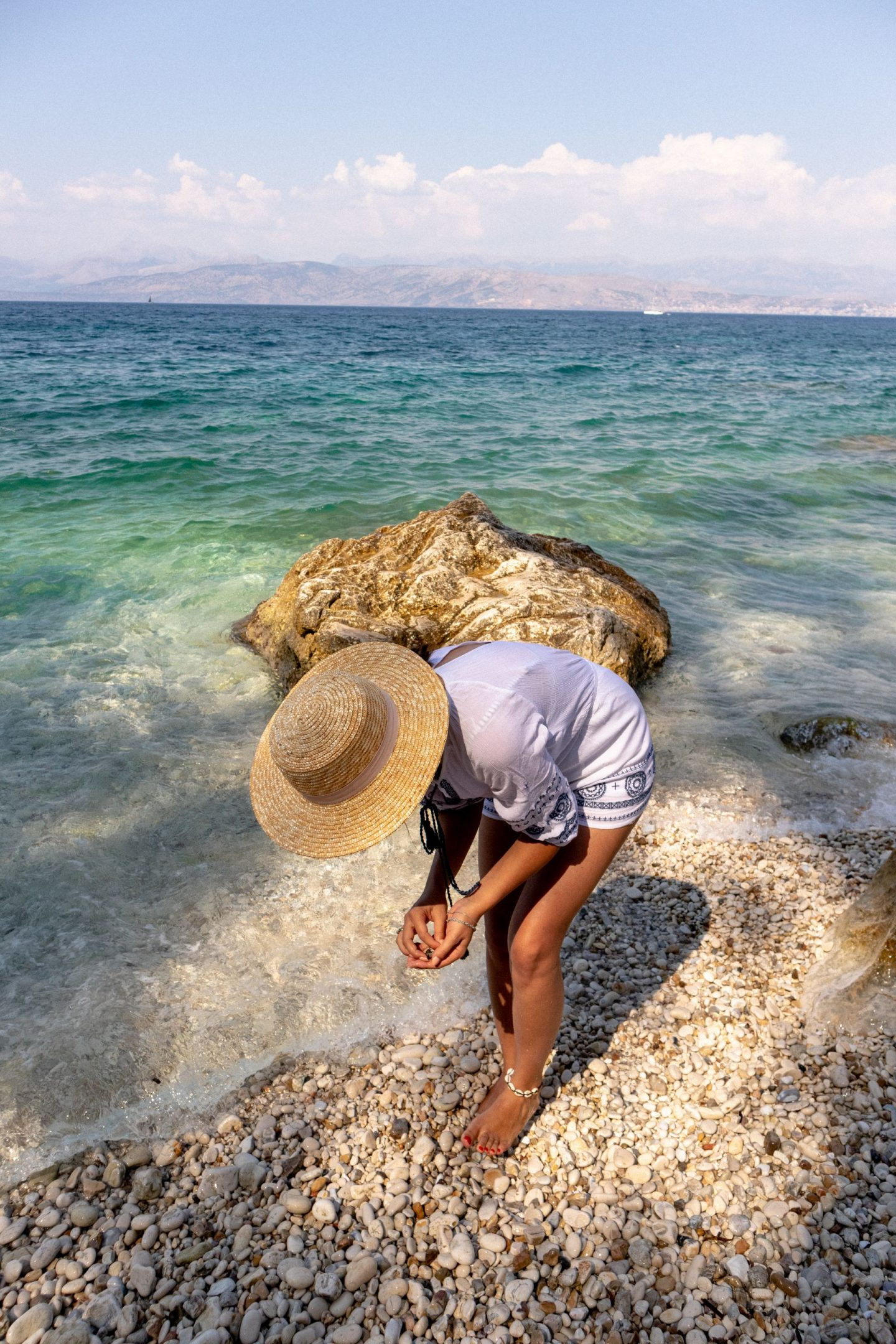 Collecting pebbles in Kassiopi